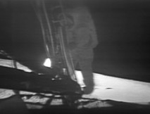Neil Armstrong (1930–2012), commander of NASA's Apollo 11 mission, descends the ladder of the Apollo Lunar Module to become the first human to step foot on the surface of the Moon.