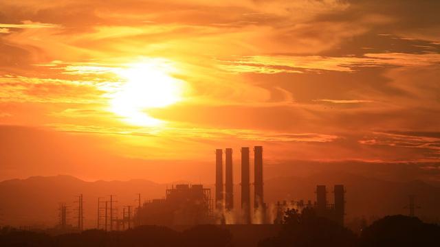 Smoke stacks in the sunset