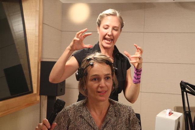 Erica Warp explains to me how the NeuroDisco works. (Josh Cassidy/KQED)