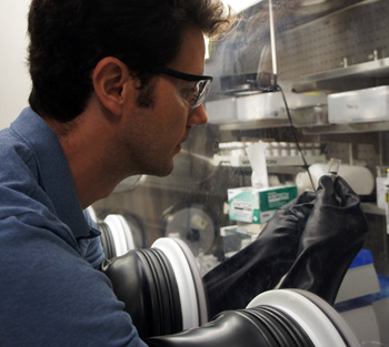 Researcher Bryan McCloskey holds a test lithium-air battery at IBM's San Jose lab. (Lauren Sommer/KQED)