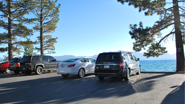 Regulators hope the new regional plan for Lake Tahoe will encourage property owners to tear out parking lots near the lake. Hard surfaces allow for dirt to run into the lake and cloud it up.  This parking lot at the Edgewood golf course, in Stateline, Nevada, is already scheduled for removal. (Arwen Curry/KQED)