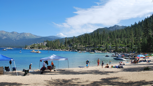 Visitors like these in Sand Harbor, Nevada, are some of the 3 million yearly tourists that fuel Lake Tahoe's economy. (Arwen Curry/KQED)
