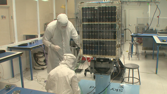 Technicians at Skybox Imaging work on a satellite in a clean room at the company's headquarters in Mountain View. Image by Blake McHugh.