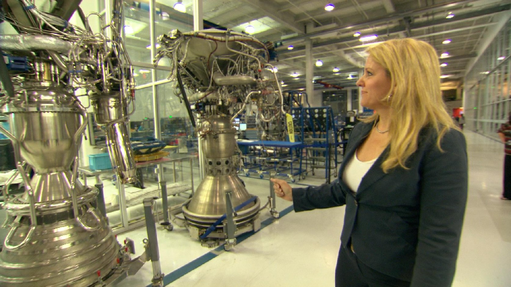 Gwynne Shotwell, President and COO of SpaceX, shows off rocket engines being built at the company's headquarters near L.A. Image by Jayme Roy