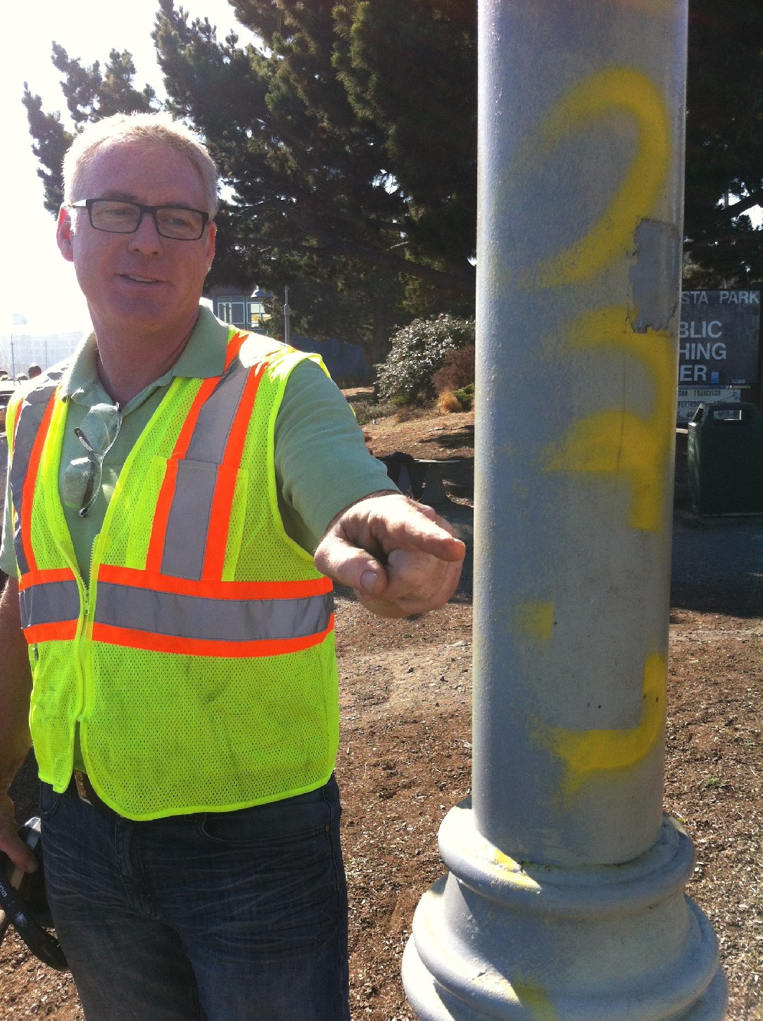 Ben Shepard points to a pole where graffiti was removed by high-pressure sand. Shephard is with Cold Jet, a company that manufactures high pressure blaster for use with sand and dry ice.