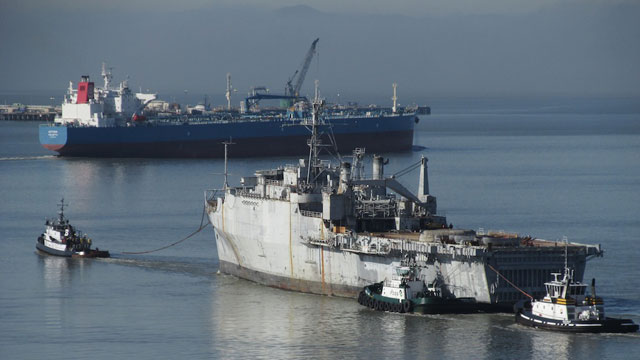 After having its hull scoured at Mare Island, retired Navy support ship is under tow, on its way to a Texas scrapyard. (Craig Miller)