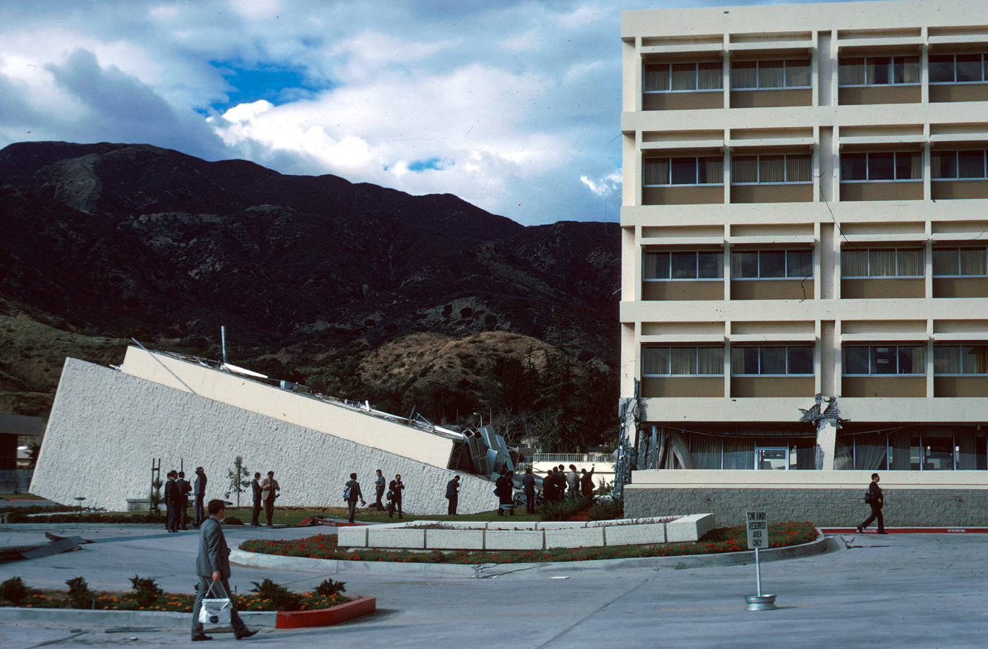 San Fernando, California, Earthquake February 1971. Fallen stair tower of Olive View Hospital, viewed across the parking lot. 1971. (U.S. Geological Survey)