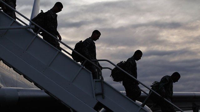 U.S. Army soldiers walk off the plane as they arrive at their home base after leaving Iraq. (Joe Raedle/Getty Images)