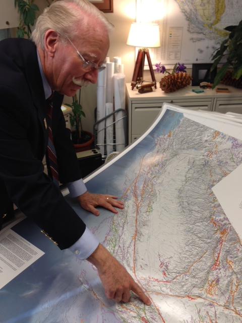 The map of California's 15,000 active fault lines covers a table in State Geologist John Parrish's office. (Sanden Totten/KPCC)