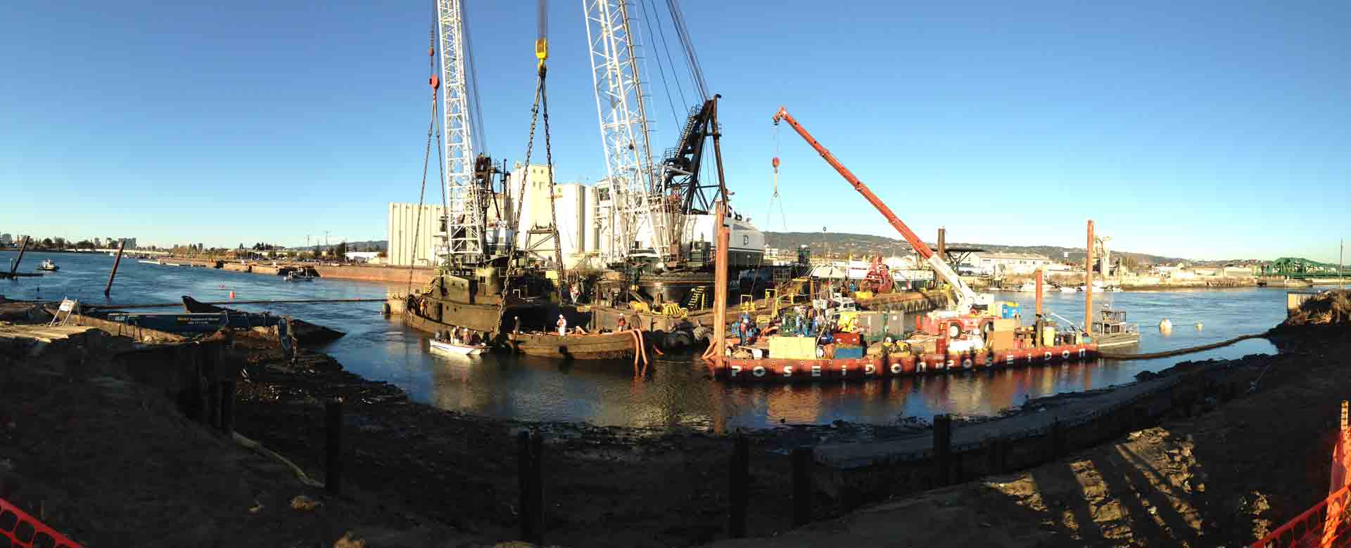 "A panoramic view as crews raise ""Captain Al,"" from the bottom of the Oakland Estuary. (Isabel Angell/KQED)"