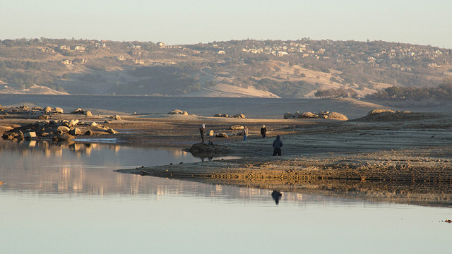 Low water levels leave much of Folsom Lake, east of Sacramento, looking like a mud flat. (Dan Brekke)