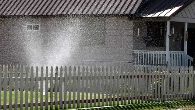 Proposed rules from state water regulators would limit outdoor watering by homeowners. (Craig Miller/KQED)