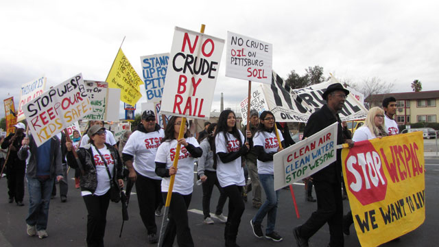 About 150 people marched to Pittsburg city hall on January 11, protesting a proposed oil terminal. (Molly Samuel/KQED)