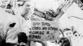 In the first  live television transmission from space, astronauts  Don Eisele and Walter Schirra Jr. deliver a message to viewers. (NASA)