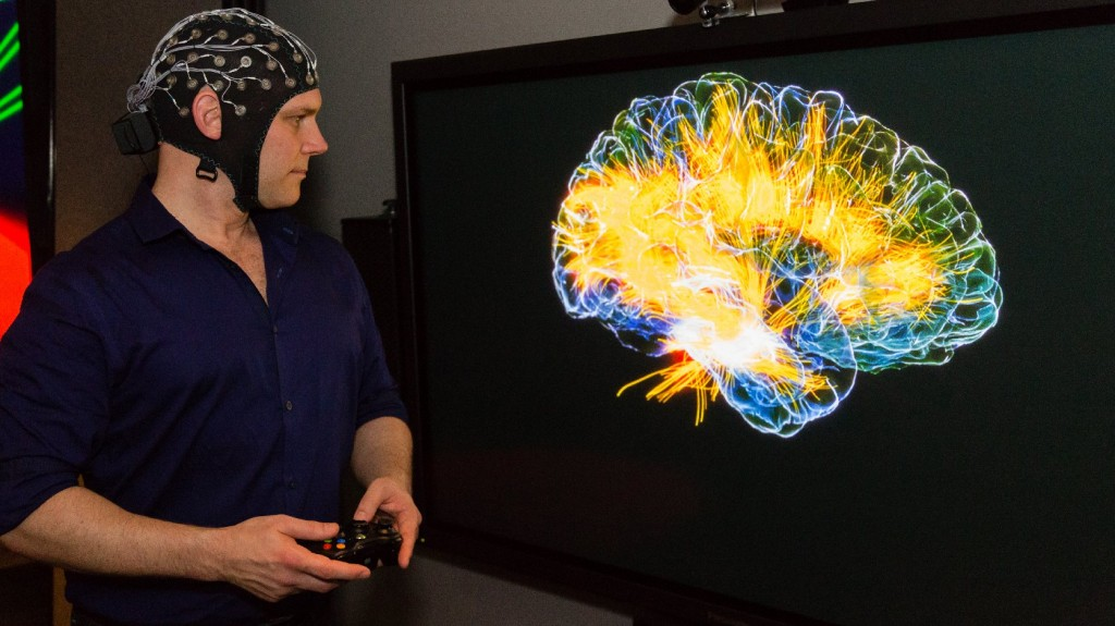 "The ""glass brain"" projects EEG data onto an MRI scan of the player's brain. (Josh Cassidy/KQED)"