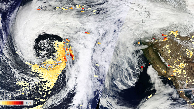 A storm approaching California on February 24th had what researchers say is a large amount of dust at the center, as shown by the orange areas. (NASA Earth Observing System Data and Information System)