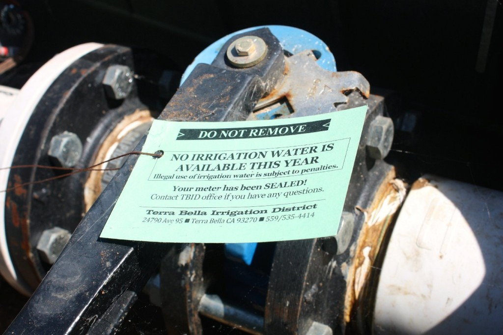 The Terra Bella Irrigation District has put a physical seal on the spigots that deliver water to farmers. There is a $10,000 penalty for breaking the seal. (Sasha Khokha/KQED)