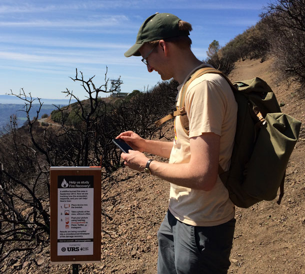 Dan Rademacher of Nerds for Nature demonstrates how the citizen science project works on Mt. Diablo. (Lauren Sommer/KQED)