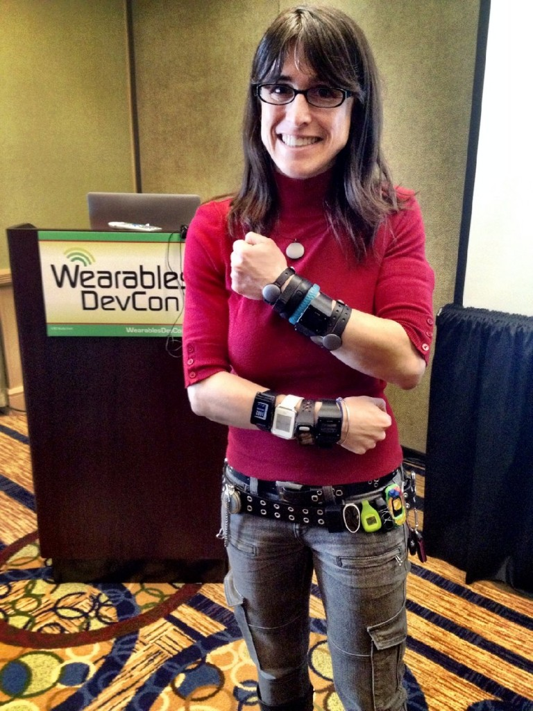 Rachel Kalmar models her activity trackers at the DevCon Wearables Conference. (Credit: DevCon Wearables Conference)