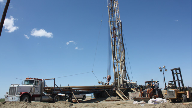 Drillers are bringing in large rigs like this one from all over the west, to drill deeper wells in the quest for water. (Sasha Khokha/KQED)