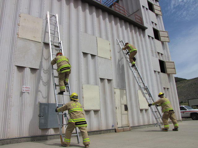 CalFire firefighters running through drills at a training facility in Napa County. (Molly Samuel/KQED)