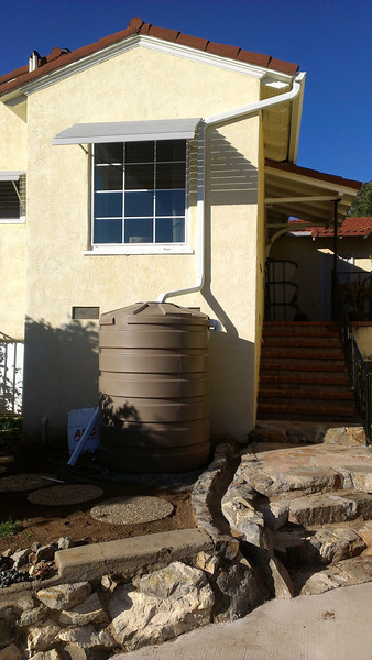 Many Australian homes now have rainwater capture systems. (Albert Barlow, Rain Water Systems)