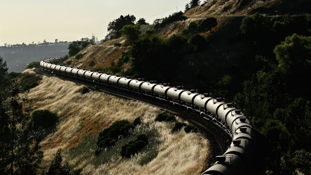 Tank cars travel near the Feather River in Northern California. (Jake Miille http://jakemiillephotography.com/)