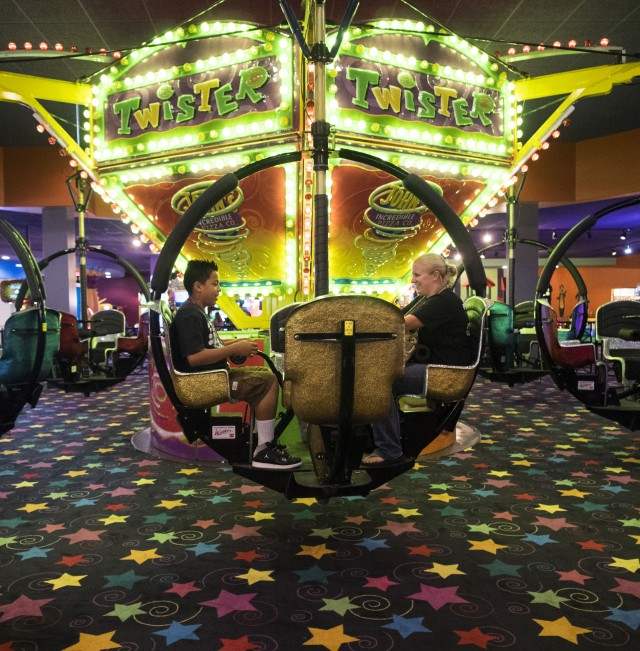 Ashley Wood, an occupational therapist at Kickstart in San Diego, took Tony, 13, out to an arcade as a reward for participating in family therapy sessions. (Marvi Lacar/KQED)