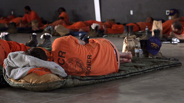 An inmate firefighter crew sleeps at a base camp in Redding after a 24-hour shift. (Adam Grossberg/KQED)