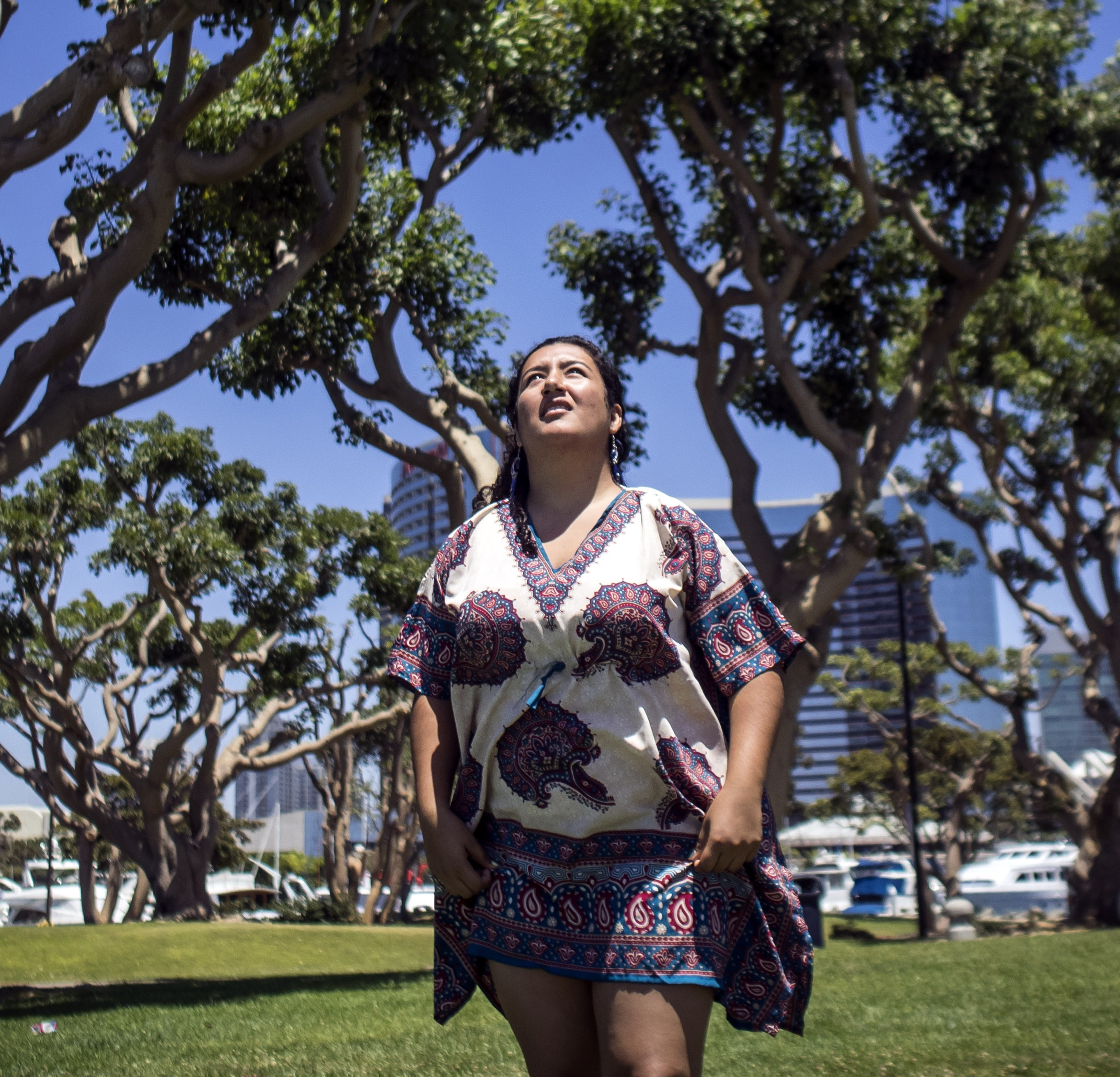 Jasmin heads out to the beach in San Diego on a windy day, to fly a kite. (Marvi Lacar/KQED)