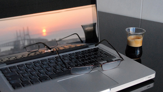 eyeglasses sitting on computer keyboard