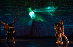 dancers use their motion to generate both sound and image from atomic physics.
