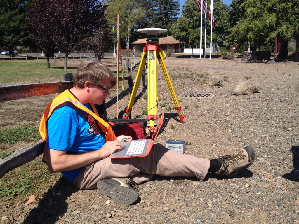 UC Riverside geophysicist Gareth Funning uses high-precision GPS antennae and benchmarks placed by the National Geodetic Survey to track ground movements in the Napa Valley. This marker is near Highway 29 in Yountville.