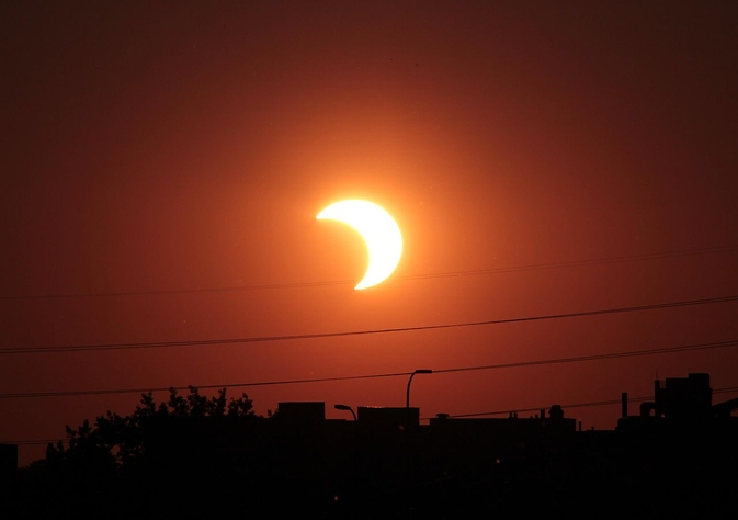 A partial solar eclipse occurs when the moon obscures only part of the sun from Earth's view. (T. Ruen/NASA)