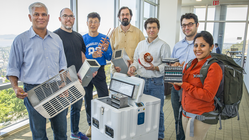 LBNL Institute for Globally Transformative Technologies research team with prototype vaccine fridge and backpack for developing countries. (Berkeley Lab / Roy Kaltschmidt)