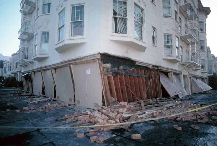 Absence of adequate shear walls on the garage level exacerbated damage to this structure at the corner of Beach and Divisadero Streets, Marina District. [J.K. Nakata, U.S. Geological Survey]