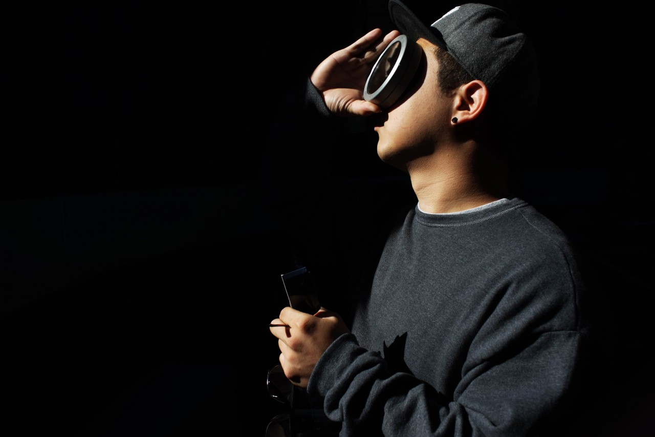 Foothill College student Seongju Choi watches the solar eclipse from the observatory in Los Altos. (James Tensuan/KQED)