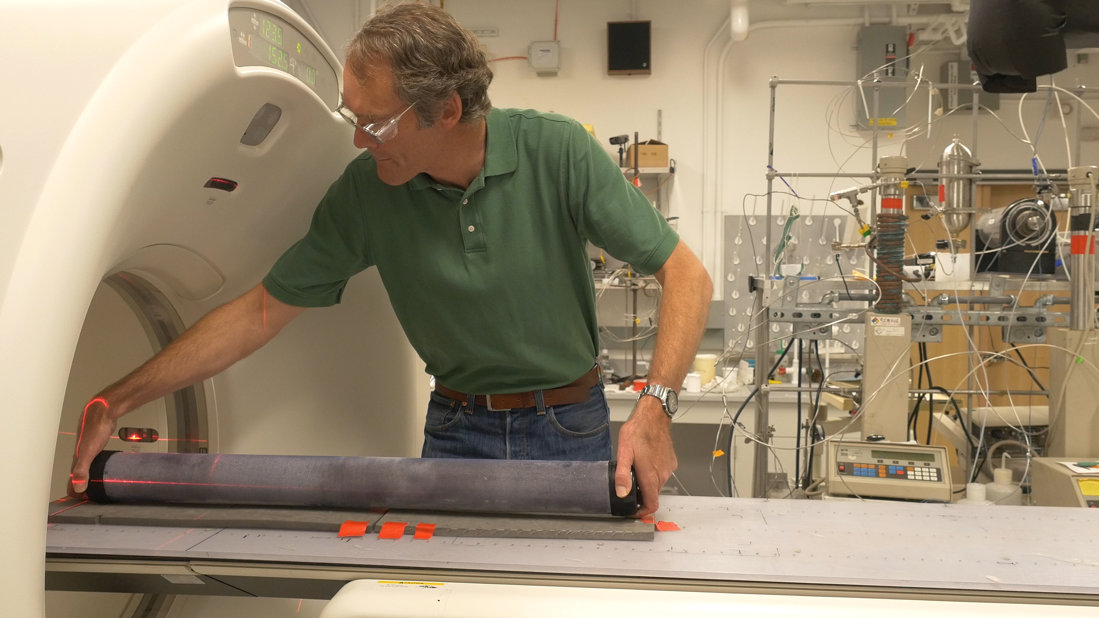 Tim Kneafsey loading a permafrost core onto a CT scanner at LBNL. Photo: Josh Cassidy/KQED