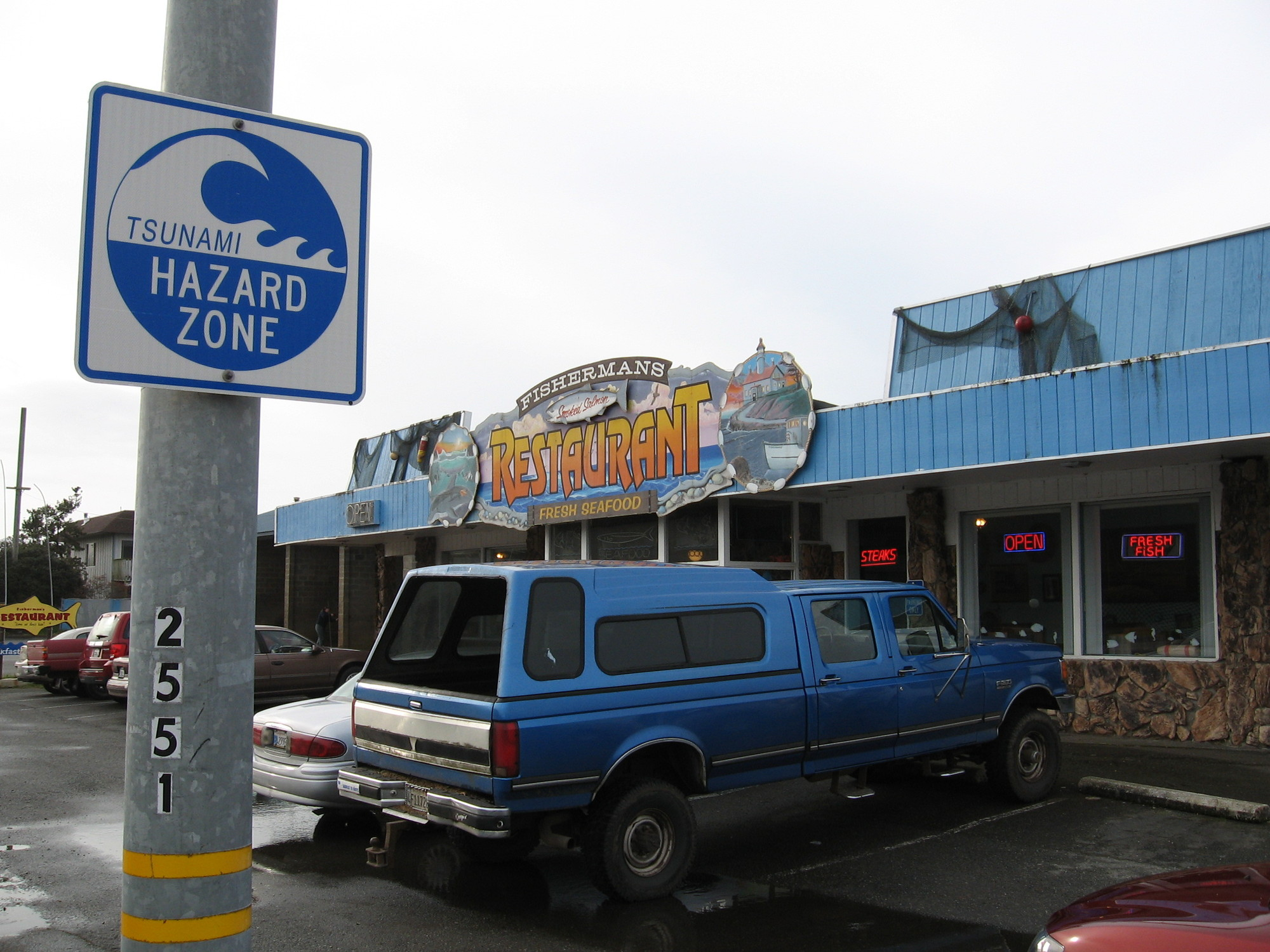 A tsunami warning sign in Crescent City, CA, which has a well-rehearsed response plan. (Craig Miller/KQED)