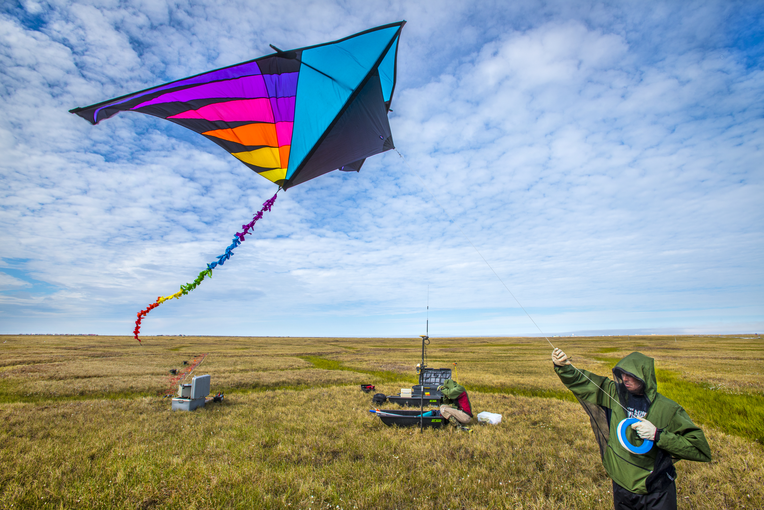 Craig Ulrich collecting imagery of the land surface using sensors mounted on a kite.