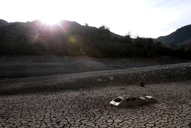 A car sits in dried and cracked earth of what was the bottom of the Almaden Reservoir on January 28, 2014 in San Jose, California. (Justin Sullivan/Getty Images)