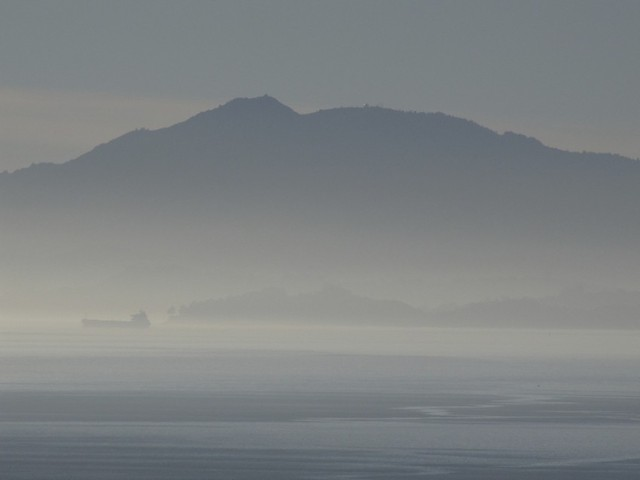 Looking west across San Pablo Bay, a tanker crosses in front of Mount Tamalpais, showing the poor air quality in December, 2013. (Craig Miller/KQED)