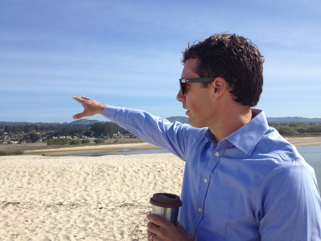 Carmel Mayor Jason Burnett stands on the beach where the Carmel River flows out to the Pacific. Burnett says he's not a fan of desalination, but the Monterey Peninsula is out of alternatives. (Daniel Potter/KQED)