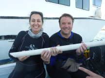 Daria Siciliano (UCSC) and Konrad Hughen, (WHOI) in Cuba with the core (Fernando Bretos/Cuba Marine Research and Conservation Foundation)