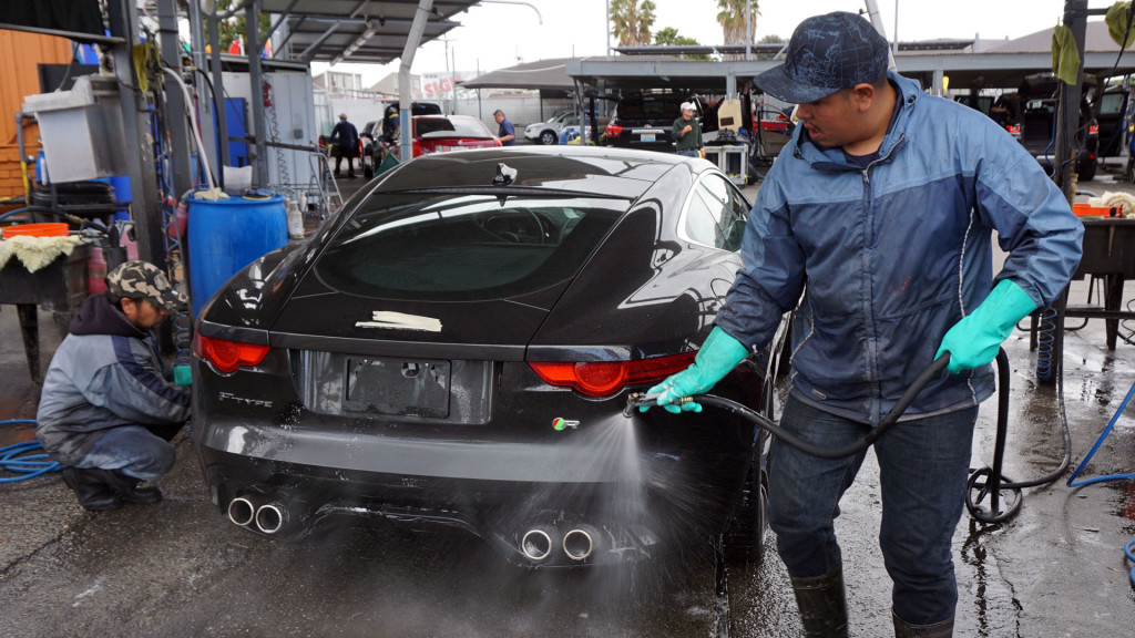 The water at AJ Auto Detailing in San Jose is recaptured and reused. San Jose has banned car washing at home with potable water. (Lauren Sommer/KQED)
