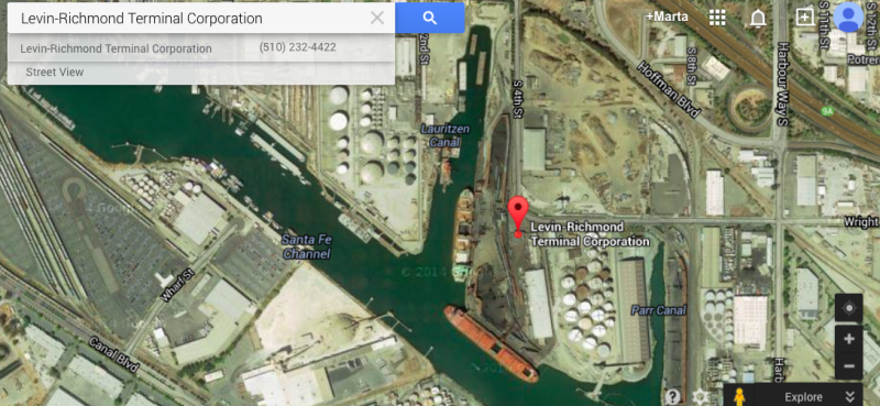 Aerial view of Levin-Richmond Terminal, via Google. The dark ovals are piles of petcoke or coal waiting for export.
