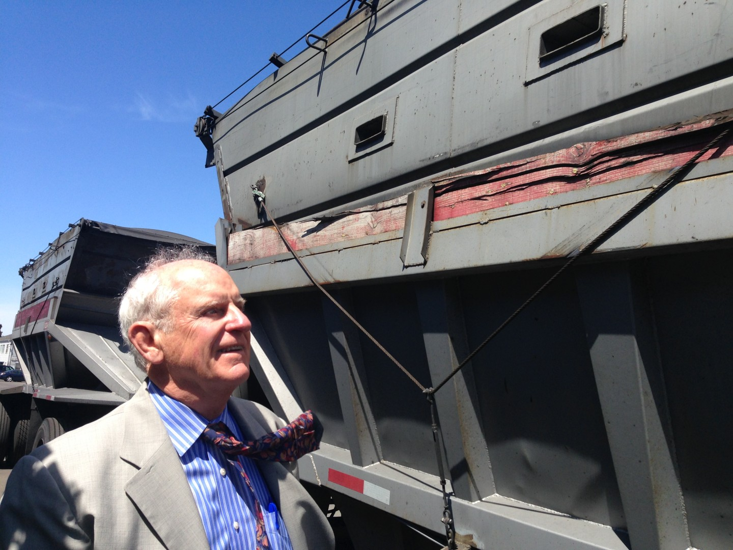 Richmond Mayor Tom Butt says he'd like to know how much coal dust blows from open piles at the Levin-Richmond Terminal. Coal particles can break down into smaller particulate matter that's harmful to lungs, as they get kicked up over and over by cars and shoes. (Julie Small/KQED)
