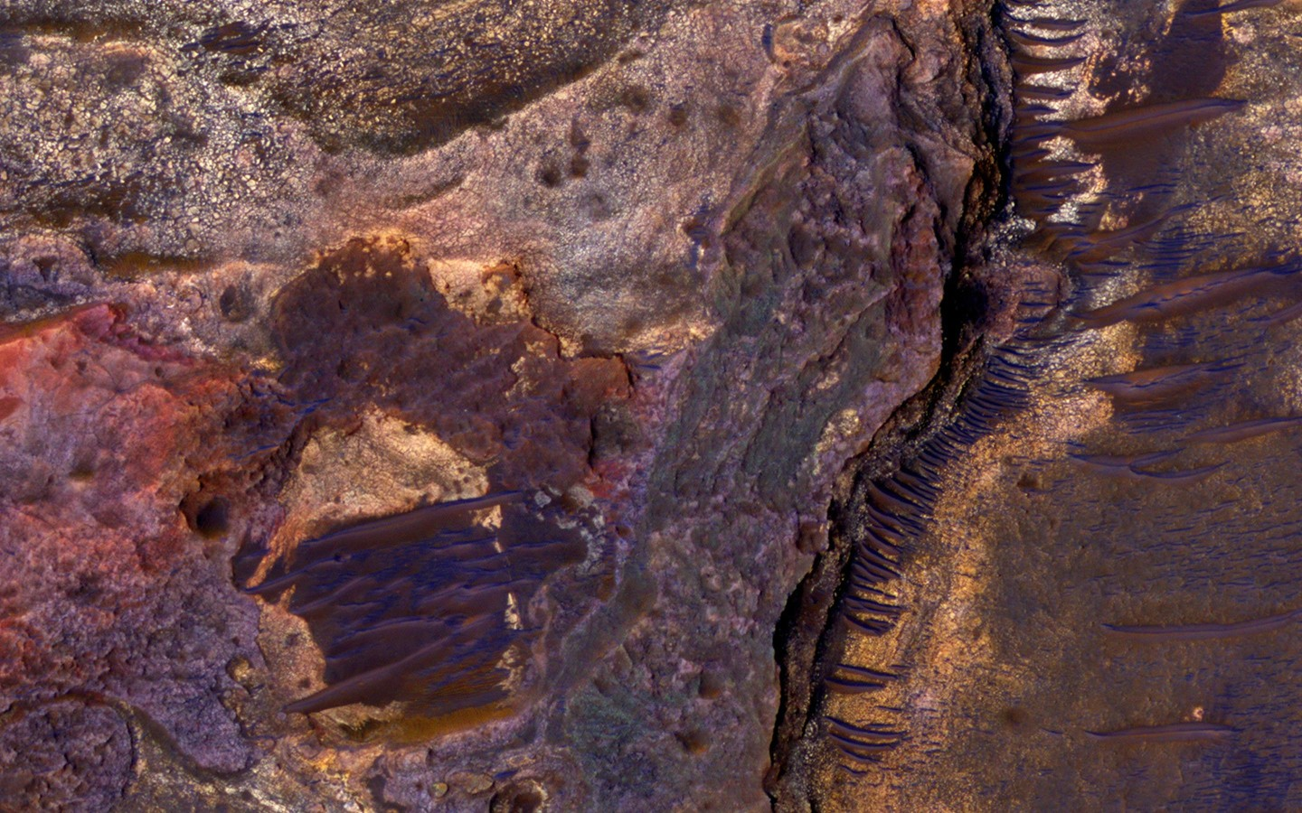 This image shows layered sedimentary rocks on the floor of an impact crater north of Eberswalde Crater. There may have been a lake in this crater billions of years ago. (NASA/JPL-Caltech/Univ. of Arizona)