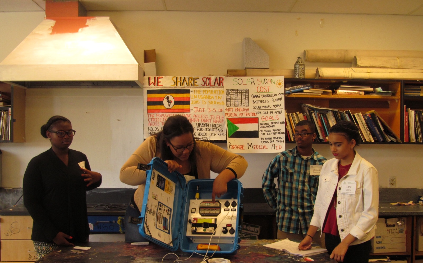 Skyline High School student Daijonne explains the capabilities of the solar suitcase that her group constructed.