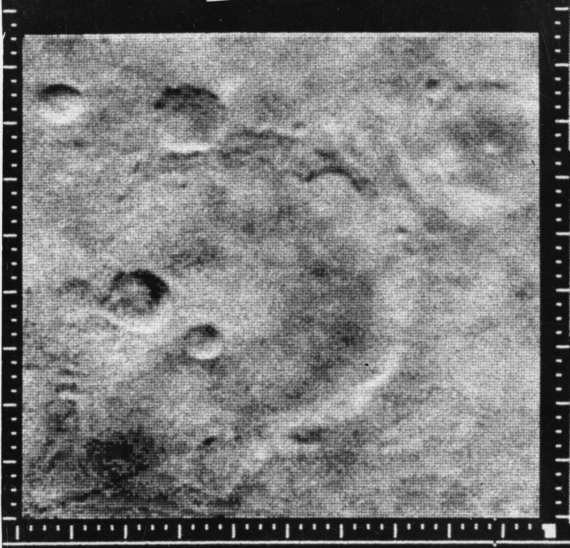 Mariner crater, snapped by the Mariner 4 spacecraft on July 15, 1965, from a distance of  7,800 miles. (NASA